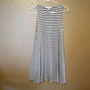 Socialite size small black in white dress